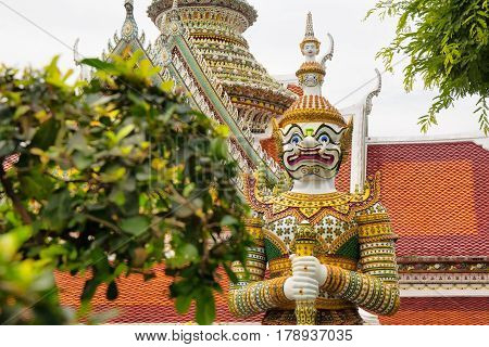 BANGKOK THAILAND - DECEMBER 10 2016: Buddhist statue of Wat Arun Tample in Bangkok