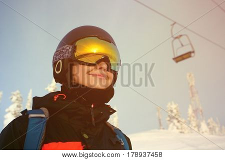 The girl with a snowboard on the alpine ski resort