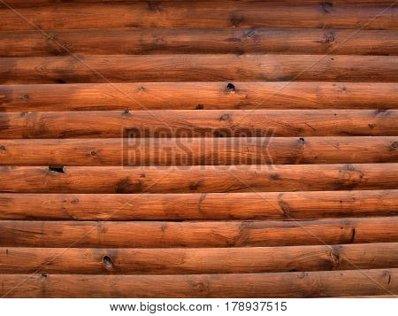 Brown background of wooden beams arranged horizontally