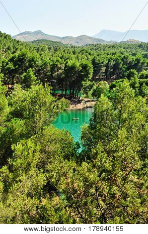 Ardales Nature Park, Conde De Guadalhorce Reservoir, Malaga Province, Andalusia, Spain - July 21, 2013: Pine forests with mountainous backdrops surround turquoise lakes.