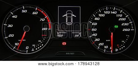 Car instrument panel, dashboard closeup with visible speedometer
