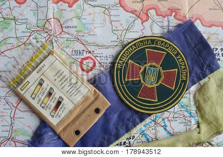 ILLUSTRATIVE EDITORIAL.Chevron of Ukraine army.Back-Map of Ukraine  with location of Balakleya .Place of arsenal explosion at 23 march. 138 kT. of TNT power.March 23 ,2017 in Kiev, Ukraine