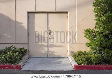 Door with little garden and cement wall lighting shading