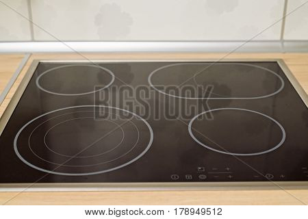 Close up of modern induction cooktop in modern kitchen
