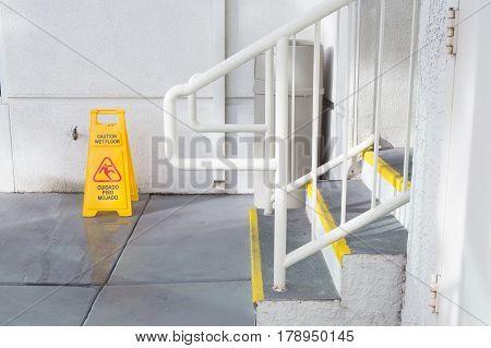Yellow Wet Floor Sign Warning Of Slippery