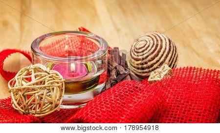 Potpourri and cinnamon sticks on burlap background.