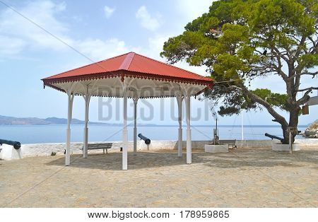 gazebo and bench with view at the ocean at Hydra island Saronic Gulf Greece