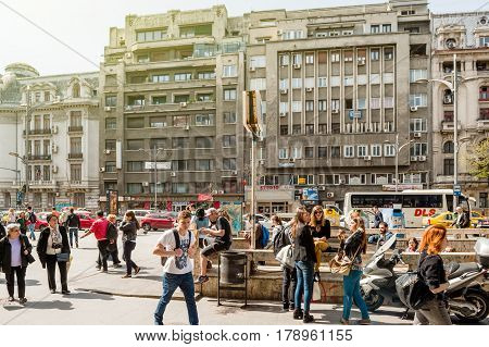 BUCHAREST ROMANIA - APR 1 2016: Pedestrians in the center of Bucharest Bulevardul General Gheorghe Magheru near the metro station entrance