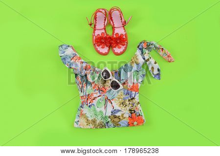 Fashion. Summer woman accessories-Summer floral scarf,hat, shoes green background