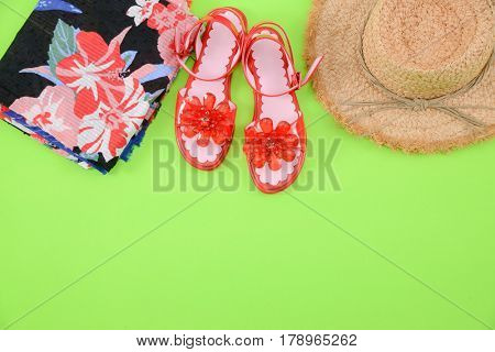 Fashion. Summer woman accessories-Summer floral scarf, shoes,hat, on green background
