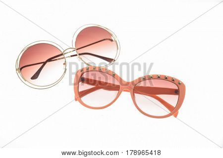 Fashionable two sunglasses on white background