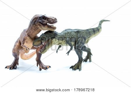 Two Green And Brown Dinosaur Tyrannosaurus Fighting And Biting - White Background