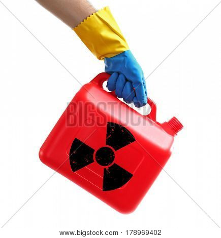 Environmental pollution concept. Hand holding can of toxic water against white background