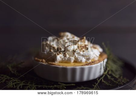 Apple tart decorated with whipped cream and cinnamon. Selective focus