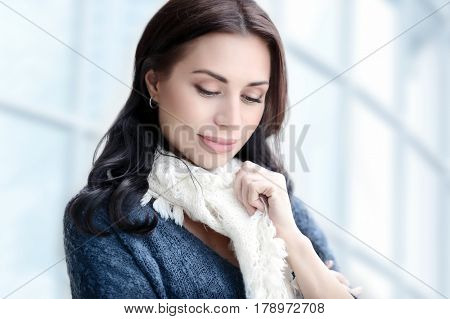 Portrait of a beautiful young business woman over office building background, natural beauty of a confident stylish female