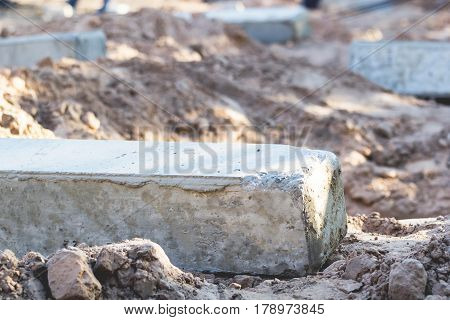 Concrete poles are placed on the ground to support the weight of the foundations of the building.