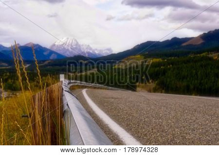 Banked curve of highway on mountain road