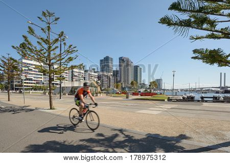 MELBOURNE AUSTRALIA - NOVEMBER 03 2016: A cyclist riding on the cycletrack at Victoria Harbour Promenade Melbourne.