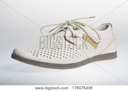 Summer men's shoes cream on a white background