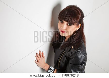 Stylish young brunette in leather jacket
