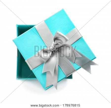 Open turquoise gift box with silver ribbon on white background