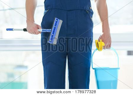 Window cleaner with special supplies indoors, closeup