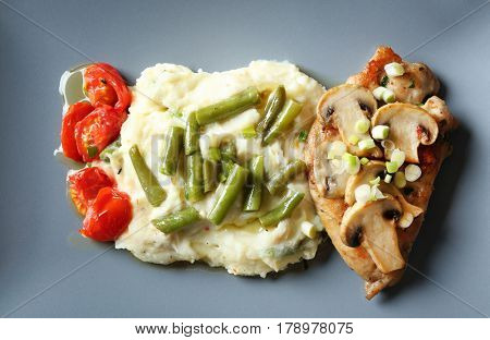 Tasty chicken marsala with vegetables on plate, close up