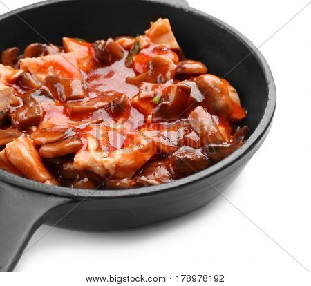 Chicken cacciatore in frying pan isolated on white