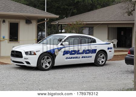 Caswell Beach NC USA - September 29 2016: One police car parked in front of the Town of Caswell Beach Police Department. One police car parked in the police department front