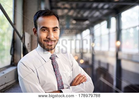 Portrait of a confident, happy business entrepreneur wearing fashionable tie and eyewear on his way to his next consultant meeting