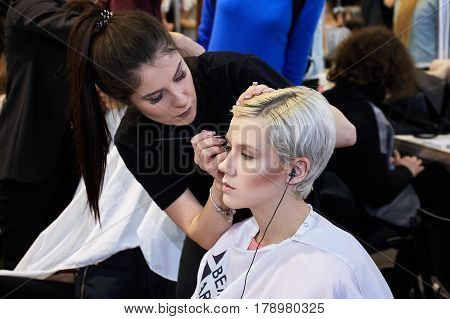 Kyiv, Ukraine - February 5, 2017: Makeup Artist At Work. Backstage Of Ukrainian Fashion Week 2017