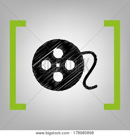 Film circular sign. Vector. Black scribble icon in citron brackets on grayish background.