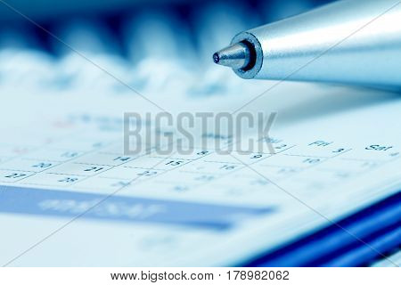 Close up pen ball with calendar page