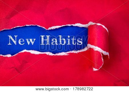 Crumpled Torn red Paper and New Habits text with a blue paper background