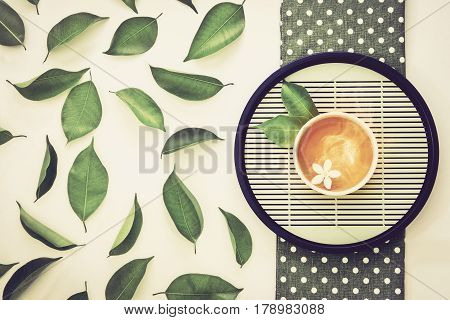 Top view shot of a hot cup of tea with green leaf decoration Organic green Tea ceremony time concept vintage color tne
