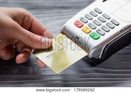 payment terminal and credit card in purchasing concept on gray table background