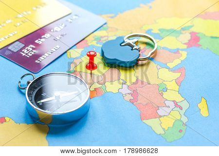 Traveling concept with credit card for online payment and on map background