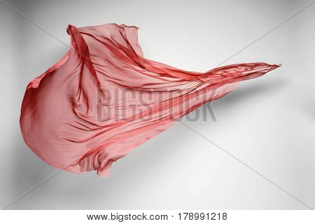 abstract piece of red fabric flying, art object, design element