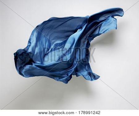 abstract piece of blue fabric flying, art object, design element