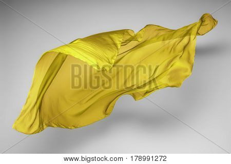 abstract piece of yellow fabric flying, art object, design element