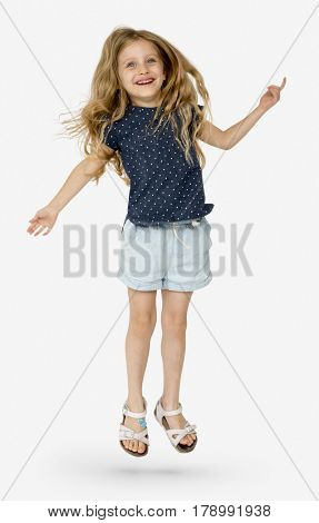 Young girl jumping with joy