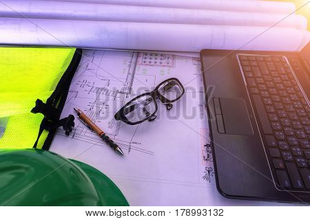 Safety helmets, safety goggles. , The fluorescent safety vest, notebooks, pens, drawing on the work of architects and construction. , The concept of safety in construction.