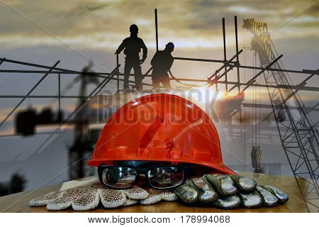 Set of safety standard , helmet , safety goggle, gas detector ,gas filter ,  work wear on  oil rig plant construction  background , image construction safety concept .