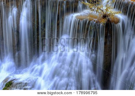 Close up waterfall at Huay Mae Kamin Waterfall, beautiful waterfall in autumn forest and wood pier , Kanchanaburi province, Thailand .