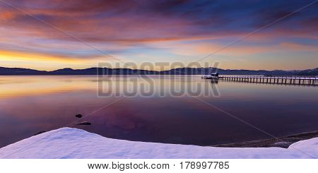 Early morning winter sunrise at Commons Beach in Tahoe City California Lake Tahoe.