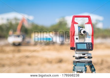 Surveyor equipment at construction site for civil and construction engineer use to checking the area for new Infrastructure project. Photo cencept for engineering work.