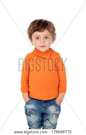 Beautiful little child two years old wearing jeans and orange jersey isolated on white background