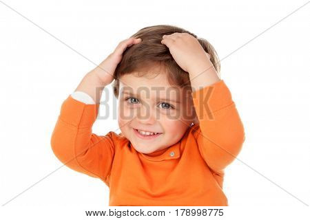 Surprised baby with his hands on the head isolated on a white background