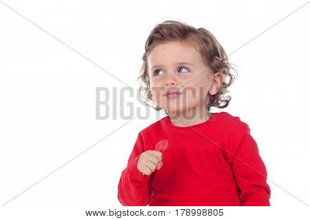 Adorable baby eating a lollipop isolated on a white background
