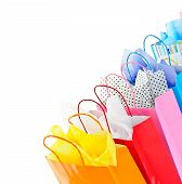 Many colorful shopping bags on white background poster